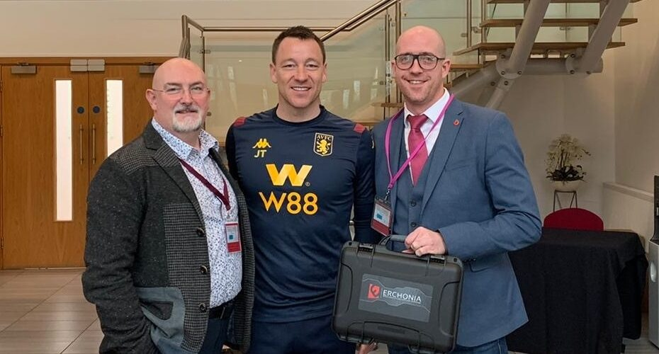 John Terry Holding Erchonia's XLR8 Laser for Getting Rid of Pains
