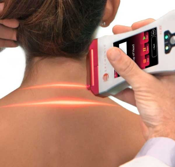 A woman getting rid of back pain fast with Erchonia's EVRL laser