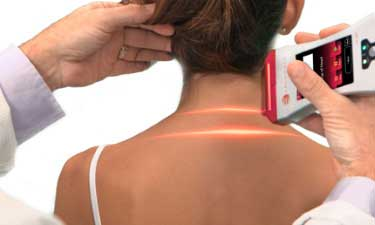 An XLR8 laser quickly removing aches and pains from a woman's back