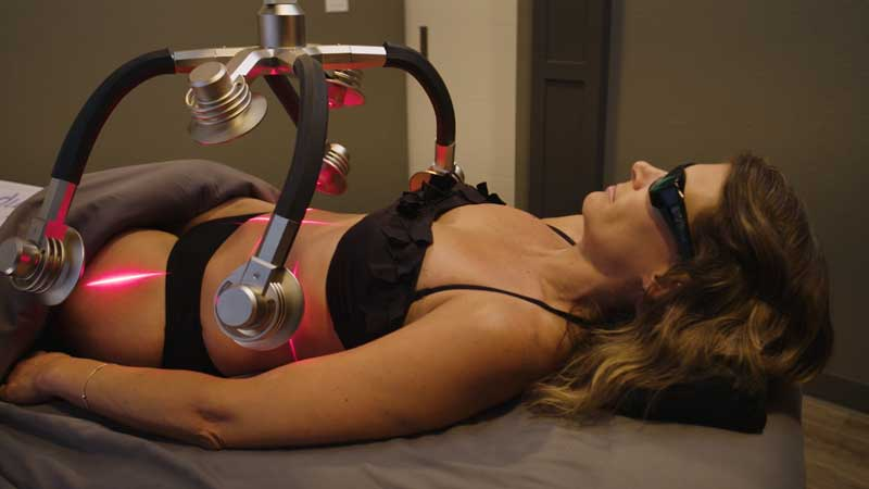 A woman quickly removing fat and cellulite with the Zerona Laser – Erchonia (UK)